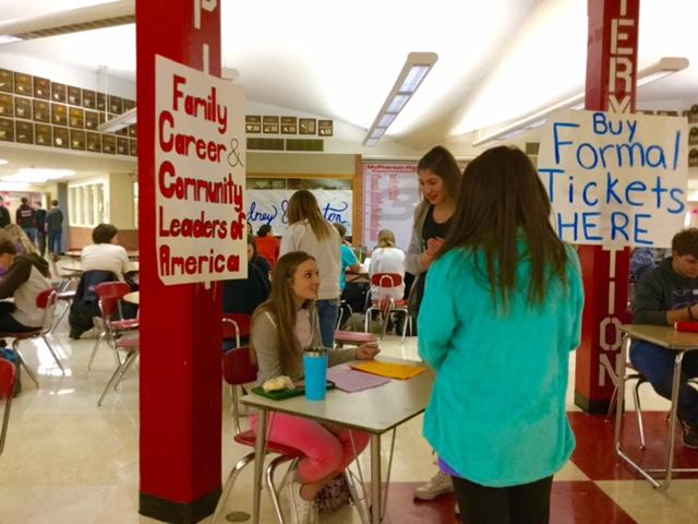 During+lunch%2C+MHS+students+wait+to+buy+a+carnation+or+cookie+from+the+FCCLA+stand.+