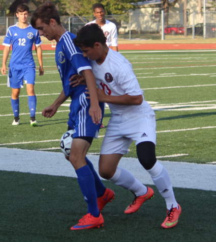 Jose Arriola puts pressure on the ball.