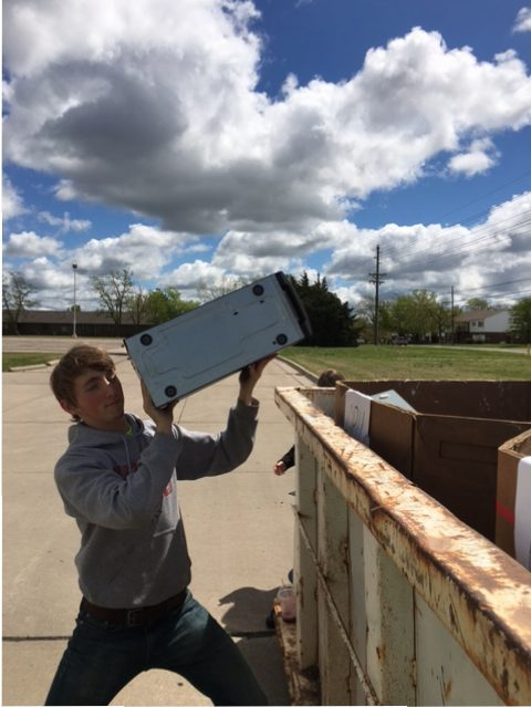 Senior Tate Johnson volunteers at the E-waste drive put on by McPherson High School