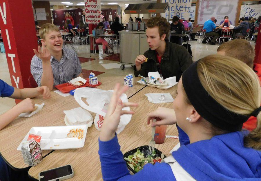 Students having fun at lunch.