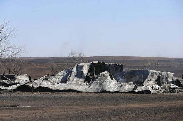 Caption: Don Milligan's barn outside of Ashland has been burned down in the fires.