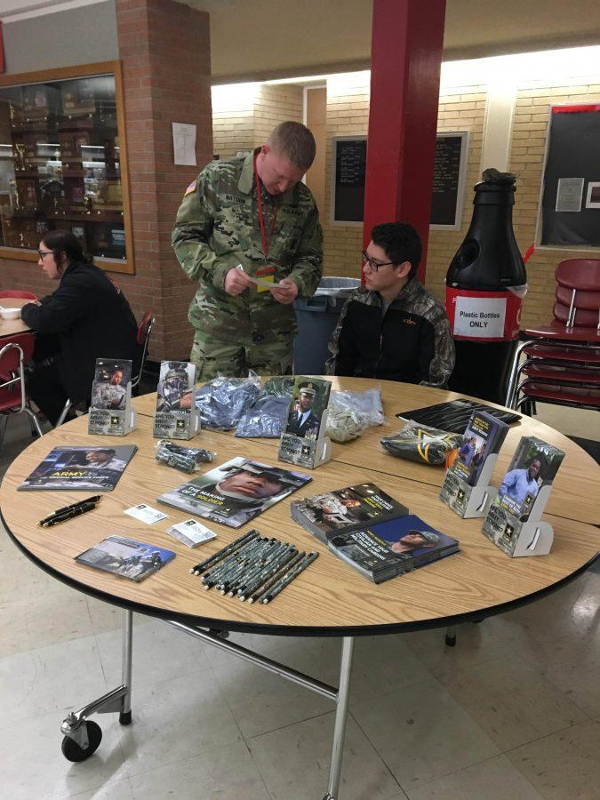 MHS student talking to army personnel who visited Wednesday, March 15.