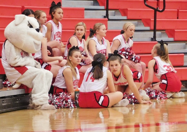 MHS cheer team sitting on the sidelines before the big tournament.