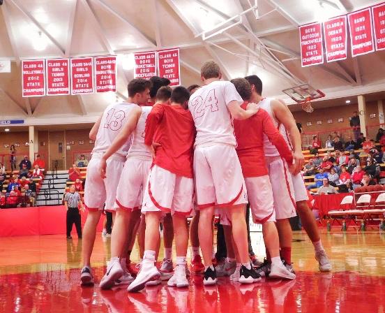 MHS basketball team huddling before the tournament against Augusta.