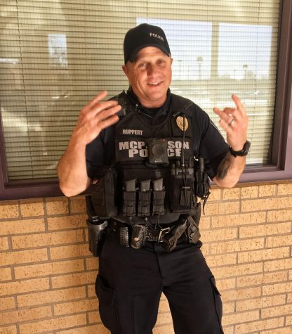 The resource officer at McPherson High School, Joey Rupert, posing his trendiest pose.