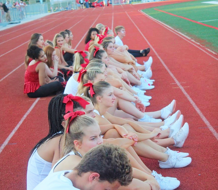 Cheerleaders+at+the+Fall+Sports+Preview+waiting+on+the+sidelines.