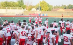The Football team getting ready for their first scrimmage.