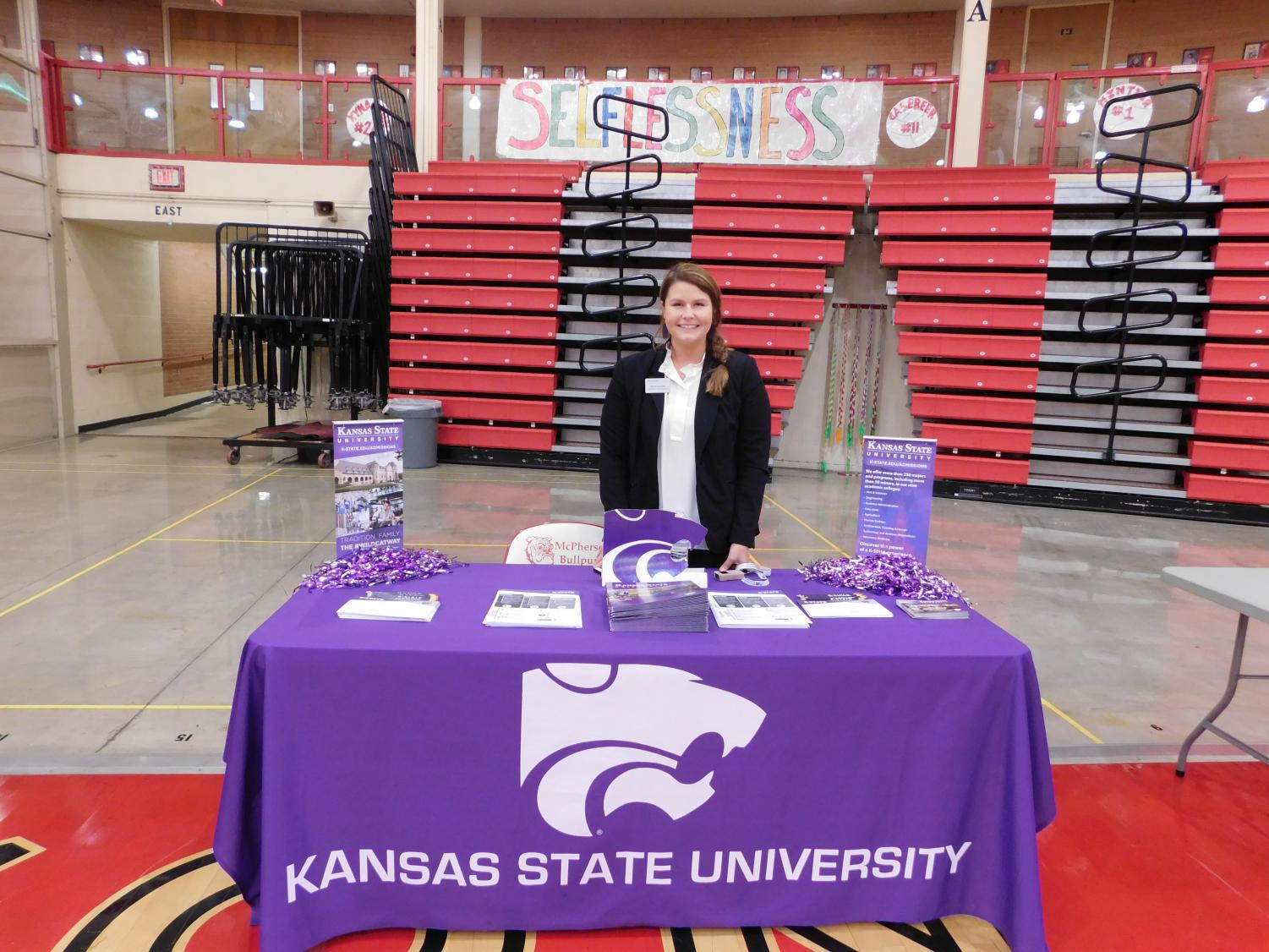 Kansas+State+University+representative+poses+for+her+photo+and+her+and+her+booth.