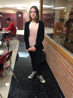 Katelynn Hull is wearing black shoes with black leggings with a pink tank-top and a black cover-up