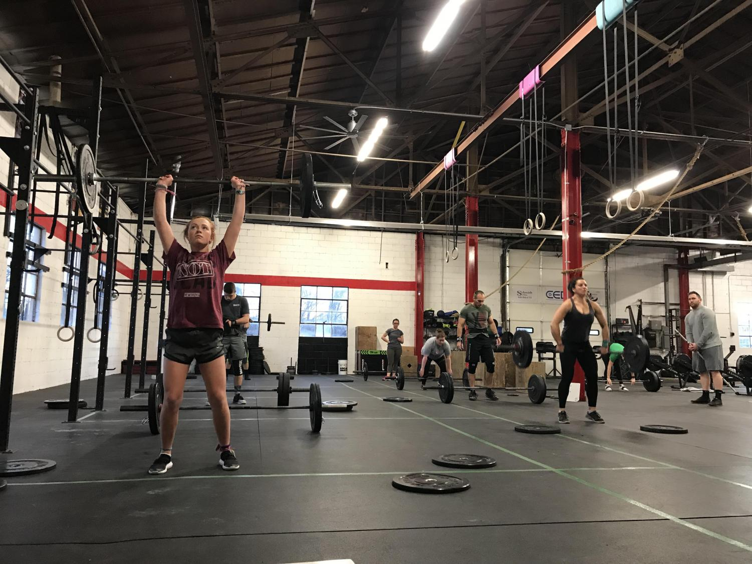 Melissa, Delilah and Robbie Mintzer exercise at Mac-Town CrossFit