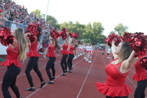 The MHS Hi-Steppers perform for the crowd at a football game.