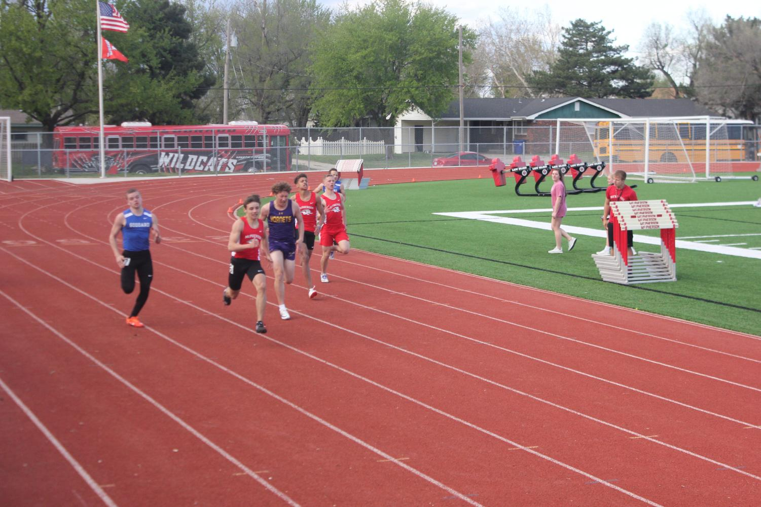 Sky+Schriner+and+other+McPherson+High+athletes%2C+pull+ahead+in+their+event.+