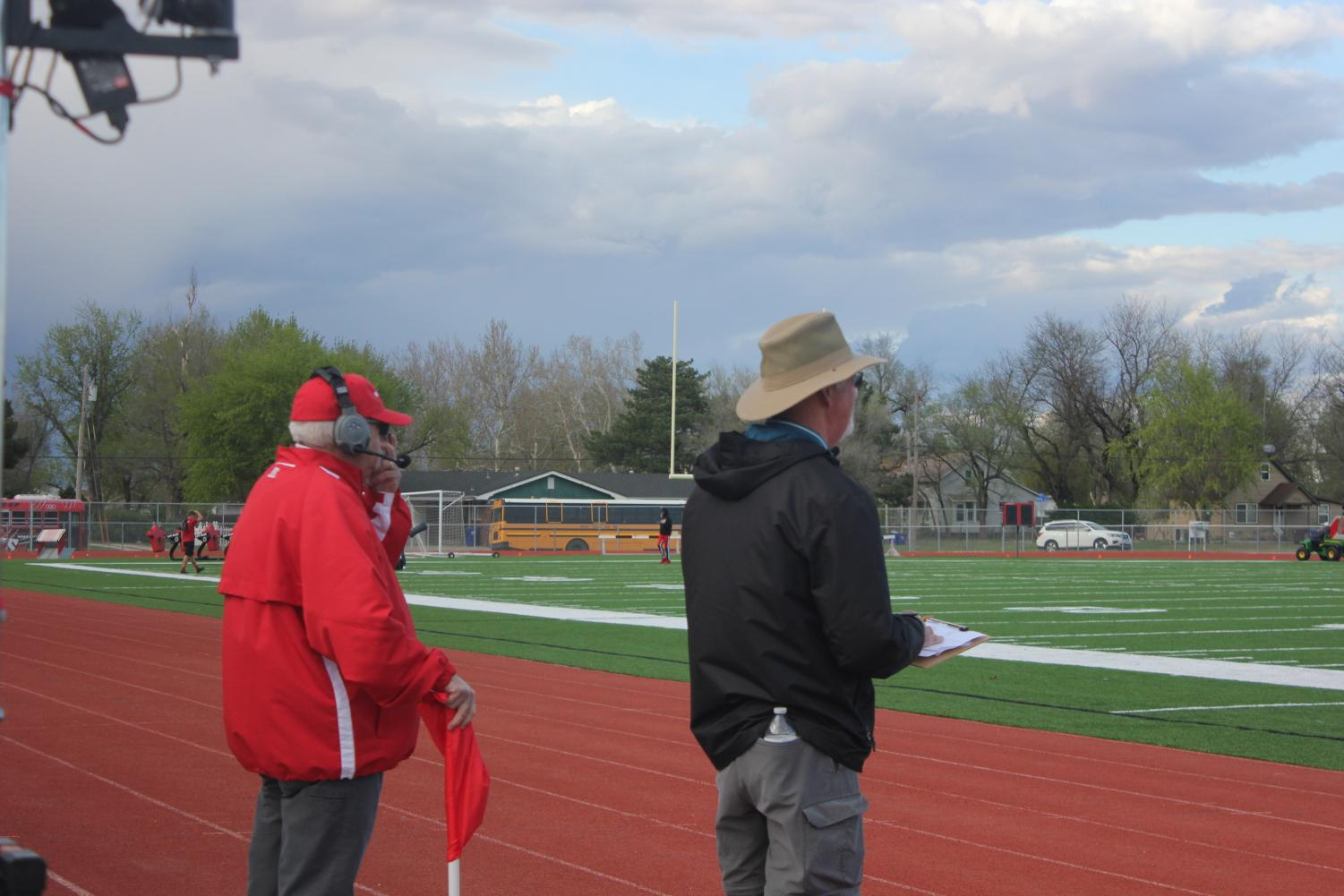 The+coaches+keep+score+and+support+the+McPherson+High+track+team.+