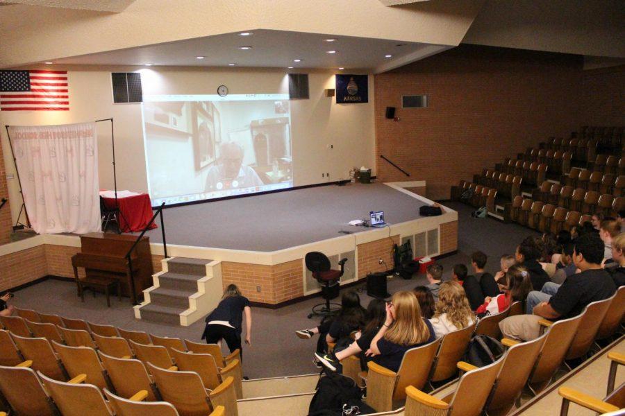 MHS students watching Holocaust survivor.