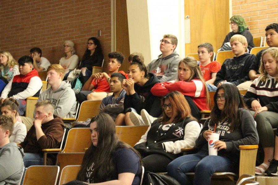 MHS students listening to the Holocaust survivors story of World War II.