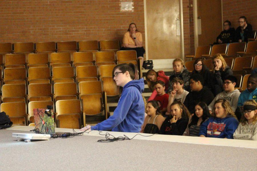 Jenifer Ford asking the Holocaust survivor a question via Skype.