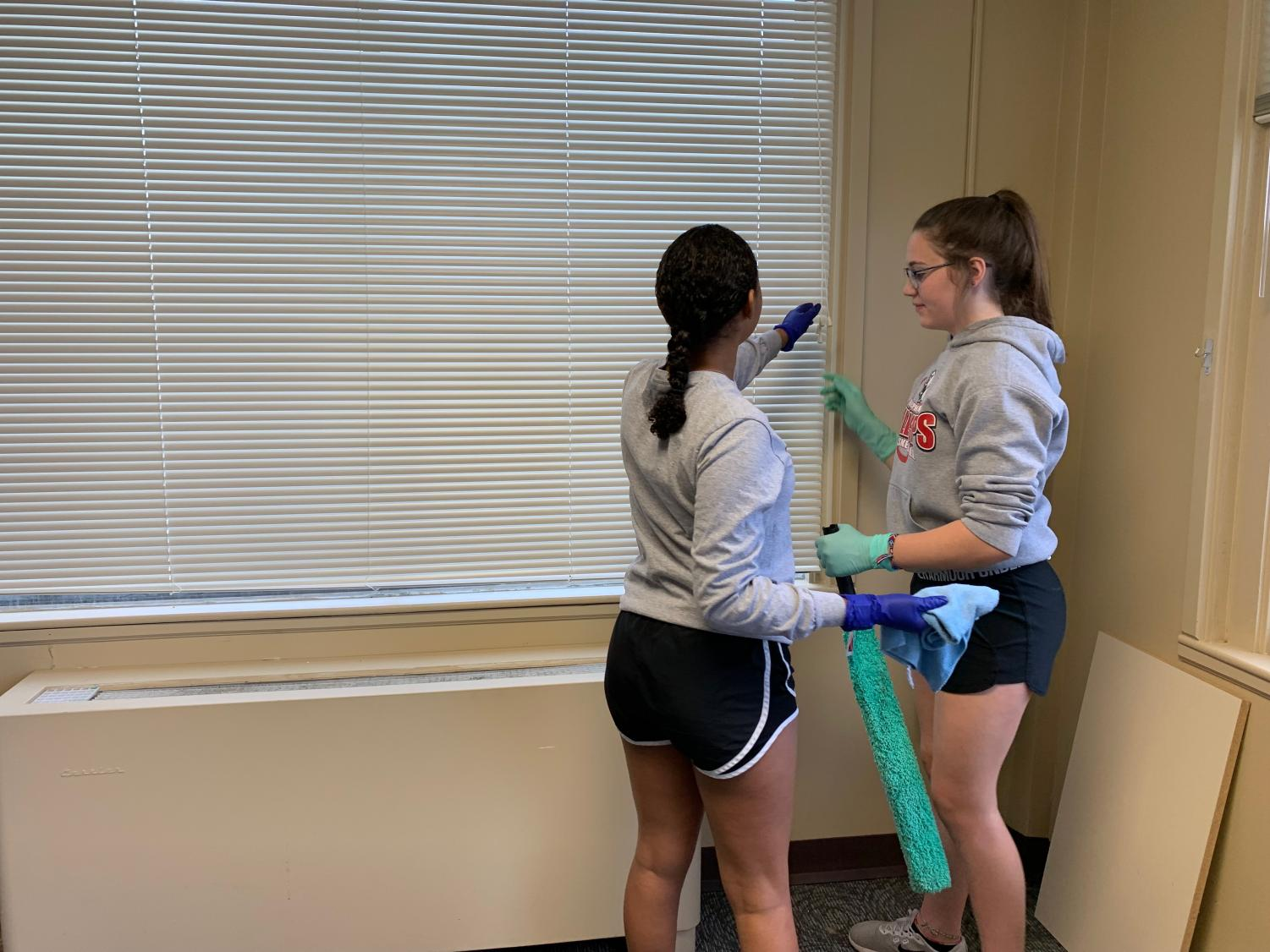 Jaice+Holler+and+Arriana+Gross+are+working+together+to+clean+the+windows+