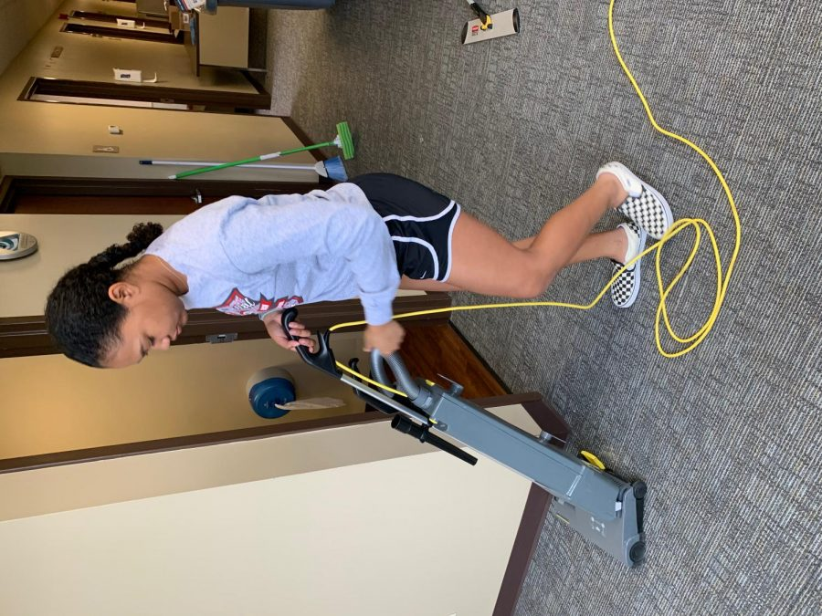 Arriana Gross is vacuuming the hospital.