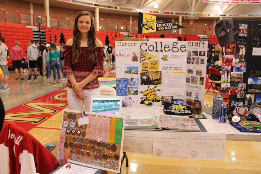 Hannah Dossett shows her many medalls and ribbions she has gotten throughout the years and the college she will be going to.