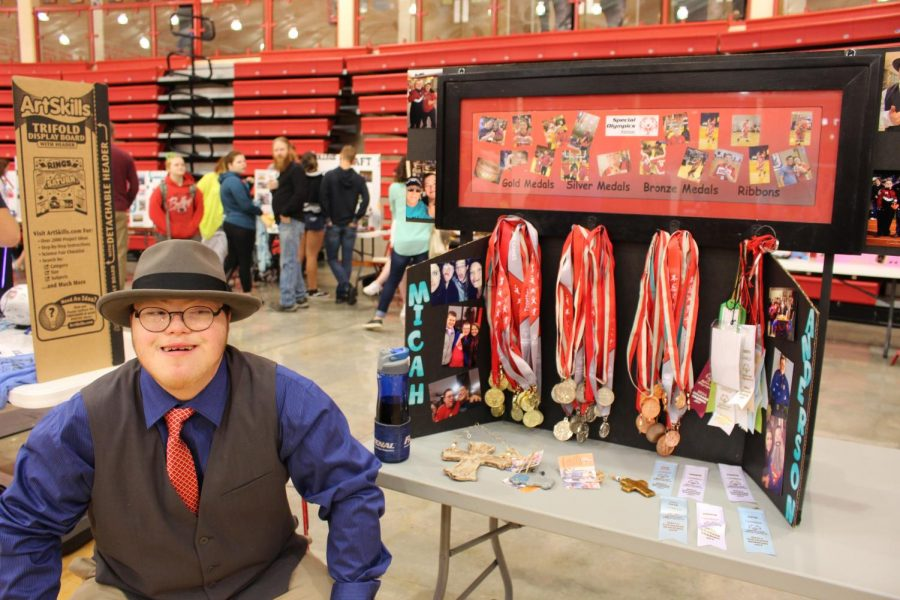 Micah Anderson shows off the many medals and ribbons that he has won.