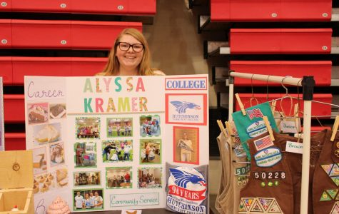 Alyssa Kramer showcases her many patches from girl scouting and the college she will be attending.
