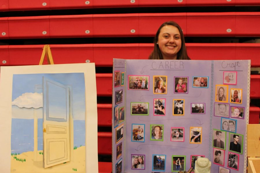 Savannah Moon stands by some of her great art pieces that she has made.