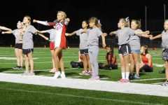 Cheerleaders and HiSteppers perform with the Lil Bullpup Clinic