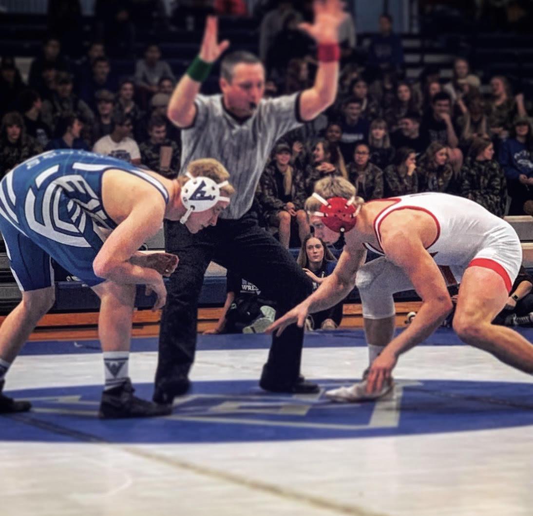 Clarke wrestling a dual in Winfield, Kansas