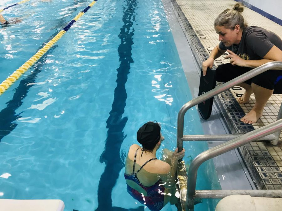One of the coaches, Angie Brunk, gives a swimmer a few pointers.