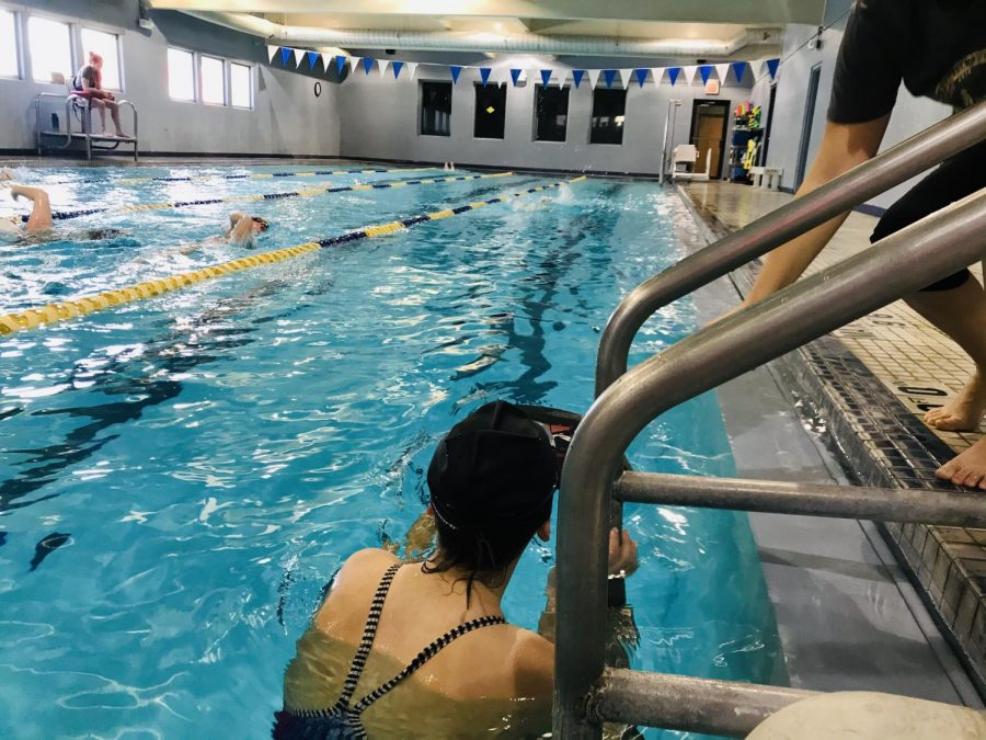 A swimmer receives a few pointers.