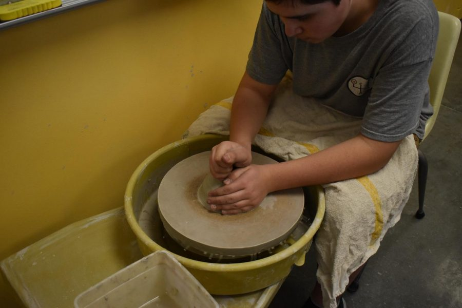 Ceramics class works on their clay projects.