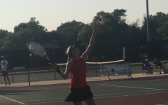 Loghan Engelbrecht tossing up for her serve