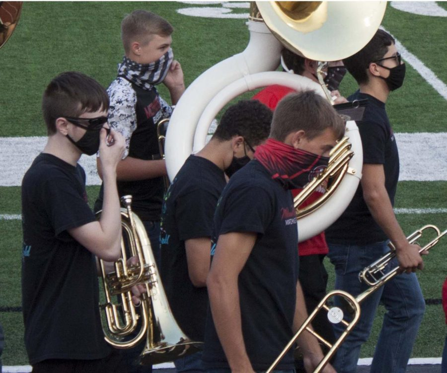 Band at football game wearing mask