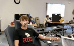 Junior, Josh Everhart, gives blood at drive.
